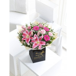 PINK RADIANCE HAND-TIED WITH CHOCOLATES, PINK RADIANCE HAND-TIED WITH CHOCOLATES