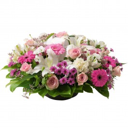 Round funeral arrangement of mixed flowers in white and pink, Round funeral arrangement of mixed flowers in white and pink